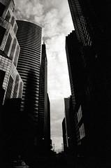 Skyscrapers (johnlishamer.com) Tags: kodaktmaxp3200 november xtol slr lishamer clouds nikonf3 nikkor24mmf28ais chicagoillinois 2018 2019 35mm film johnlishamercom