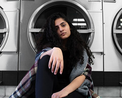 (sonia balani) Tags: portrait toronto canada project pose grey friend gray longhair experiment neighbourhood coinlaundry newplaces neighbourhoodlaundry dslr dryer headtilt center curlyhair hand tilt