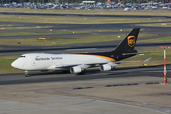 UPS Queen into Sydney (3 of 3) (Jungle Jack Movements (ferroequinologist) all righ) Tags: ups united states postal service n 572up 747 jumbo vh sydney international airport kingsford smith botany bay 16r mascot queen centrepoint tower city view one world boeing fly flying flown trip passenger wing airborne rapid takeoff land touchdown jet airplane aeroplane aircraft journey aerial inflight landing plane airliner wind sky turbulence aisle window captain crew terminal gear 飞机飛行機 самолет aereo avion aerobatics fuselage altitude pilot navigator radar turbo honolulu hawaii anzac bridge 5x32