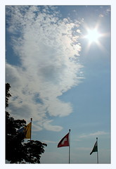 flags (overthemoon) Tags: switzerland suisse schweiz svizzera romandie vaud vevey evening sun clouds sky flags utata ip 285 ironphotographer utata:project=ip285 flare