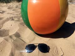 Beach ball and sunglasses stock photo image (bmstores) Tags: beach summer stock sunglasses black bring bright uv sun beachy sand ball coloured glare tan burn lifeguard sea water waves tide beaches england uk merseyside west kirby image photo boy shadow shorts t shirt