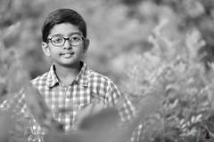 Vrisan  {EXPLORED} (rajnishjaiswal) Tags: boy vrisan vrisanjaiswal nature portrait bw blackandwhite smilingboy smiling dof plant leaves garden park