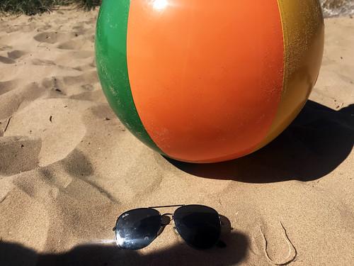 Beach ball and sunglasses stock photo image