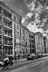 Speeding up Columbia Road (marc.barrot) Tags: shotoniphone monochrome skateboarding street building urbanlandscape streetphotography uk e2 london shoreditch columbiaroad
