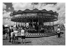 FILM - Carousel (fishyfish_arcade) Tags: 35mm analogphotography bw blackwhite blackandwhite filmphotography filmisnotdead hp5 istillshootfilm monochrome nikkor2880f3556afd nikonf80 sheffieldsteamrally analogcamera compact film ilford mono carousel streetphotography