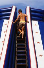 Summer is here (rob kraay) Tags: inflatablewaterslide clouds robkraay woodenstairs sky people waterfun