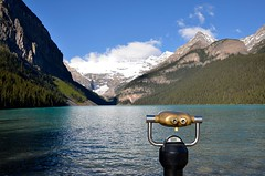 View on Lake Louise (rob kraay) Tags: binoculars mountains robkraay snow forest canadianrockies clouds canada bluesky pinetrees alberta woods lake glacier shore