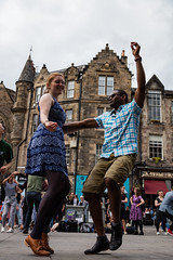 Edinburgh Swing Dance Society Grassmarket July 2019-150 (Philip Gillespie) Tags: edinburgh city urban swing dance society scotland grassmarket men women boys girls kids family friendly hands feet heads arms legs colour blue green red yellow castle outdoor outside canon 5dsr photography event workshops classes public lindy hop dresses hair faces shoes moving open spaces street pavement