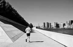 Miles to Go (Kenneth Laurence Neal) Tags: newyorkcity urban skyline cityscape people running blackandwhite blackdiamond monochrome monotone nikond7100 cities eastriver