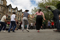 Edinburgh Swing Dance Society Grassmarket July 2019-234 (Philip Gillespie) Tags: edinburgh city urban swing dance society scotland grassmarket men women boys girls kids family friendly hands feet heads arms legs colour blue green red yellow castle outdoor outside canon 5dsr photography event workshops classes public lindy hop dresses hair faces shoes moving open spaces street pavement
