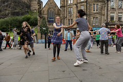 Edinburgh Swing Dance Society Grassmarket July 2019-217 (Philip Gillespie) Tags: edinburgh city urban swing dance society scotland grassmarket men women boys girls kids family friendly hands feet heads arms legs colour blue green red yellow castle outdoor outside canon 5dsr photography event workshops classes public lindy hop dresses hair faces shoes moving open spaces street pavement