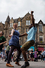 Edinburgh Swing Dance Society Grassmarket July 2019-151 (Philip Gillespie) Tags: edinburgh city urban swing dance society scotland grassmarket men women boys girls kids family friendly hands feet heads arms legs colour blue green red yellow castle outdoor outside canon 5dsr photography event workshops classes public lindy hop dresses hair faces shoes moving open spaces street pavement