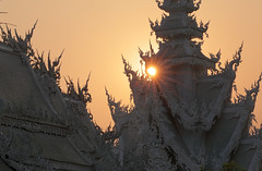 Sunset Over The White Temple (peterkelly) Tags: digital canon 6d southeastasia asia thailand indochinaencompassed gadventures paodonchai watrongkhun whitetemple ubosot temple roof sunset evening orange sun dusk happyplanet asiafavorites