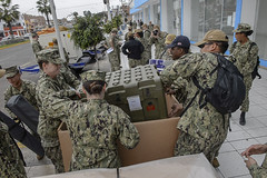 Sailors assigned to USNS Comfort (T-AH 20) set up a U.S. Navy medical site.