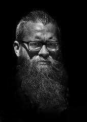 Portrait (D80_538222) (Itzick) Tags: denmark copenhagen candid bw blackbackground bwportrait beard man glasess streetphotography portrait face facialexpression d800 itzick