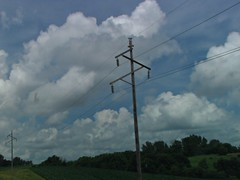 Zig-Zag Crossarms (novice09) Tags: htt telegraphtuesday poles wires clouds sky ipiccy
