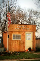 Open Daily, Except Today -- Cadwell, (IL), Post Office (forestforthetress) Tags: cadwell illinois postoffice building sign letters words flag usflag humor outdoor color rural nikon enjoyillinois travelillinois unlimitedphotos