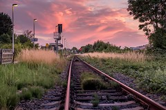 Railroad - Blue Hour (And Hei) Tags: bahnhof bahnsteig railroad rails sunset bluehour blauestunde kuchenheim euskirchen eifel colors hdr sky clouds wolken fujixt100 meike25mm