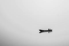 Le pêcheur (The_Forgotten_Legacy) Tags: slovenie slovenia slovenian black white noir et blanc brume fog bateau barque boat small lac alke lake morning matin mirror miror mirroir miroir eau water pecheur fisheur man