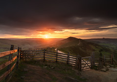 Mam Tor - Sunrise (Anthony White) Tags: hope england unitedkingdom peakdistrict hill fence sunrise grass orange sunburst pathway gate moody sky