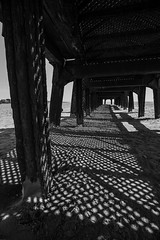 Perforations (subterraneancarsickblues) Tags: lancashire coast beach seaside pier stannespier landingjetty bw blackandwhite stannes fylde canon 6d eos6d 1635mm f4l lseries wide wideangle shadows