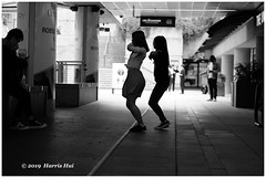Dancing On The Street - Robson Square XT7202e (Harris Hui (in search of light)) Tags: canada vancouver fuji bc richmond fujifilm xt1 fujix mirrorless harrishui vancouverdslrshooter fujixseries digitalmirrorlesscamera fujixcamera fujixt1 fujixambassador fujizoomlens fujixf50140mmf28 street dancing streetphotography robson robsonsquare bw blackwhite monochrome dancers youngpeople teenager protest hongkong