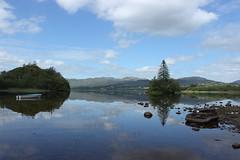 Lough Eske. (mcginley2012) Tags: lougheske codonegal ireland tree boat reflection mountains cloud lake landscape stones summer2019 bluestacks solis