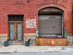 Warehouse Doors (J Wells S) Tags: doors bricks factorydoors warehouse wall urban urbandecay star west endcincinnatiohiotraffic cone