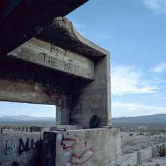 1972 the best. carrara, nv. 2016. (eyetwist) Tags: eyetwistkevinballuff eyetwist nevada carrara beatty ruins abandoned arches lonely desolate roadtrip film 6x6 120 mamiya 6mf 50mm portra 160 mamiya6mf mamiya50mmf4l kodakportra160 ishootkodak ishootfilm analog analogue emulsion mamiya6 square mediumformat primes filmexif iconla epsonv750pro lenstagger 6 highdesert roadsideamerica americantypologies usa desert landscape west rural concrete cement elizalde works plant factory decay foundations us95 architecture building arch symmetry geometric mojavedesert deathvalley pockmarked scarred bulletholes bullet marble quarry portlandcement mine clouds graffiti 1972 ruin