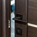 Dark metal handle on a open wooden door