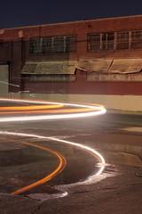 Arc tail lights (ADMurr) Tags: la eastside night industrial truck light curve puddle hasselblad 500cm 50mm zeiss distagon kodak ektar 120 crop dad937