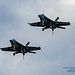 TWO F/A-18E JETS MAKE A FLYPAST WITH TAILHOOK DOWN