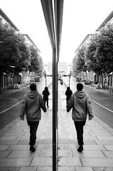 Techno walk (ermanno_arno) Tags: streetphotography street photography brighton uk canon 550d tokina 28mm 28 tokina2828 canon550d walk bnw bw black white ermanno arno vintage lense vintagelense manual focus mirror reflection city glass techno