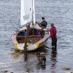 Launching (Geoff France) Tags: dinghy sailingdinghy yacht regatte findhorn findhornregatta sea bay sand water shore mast boom sail halyard sheet