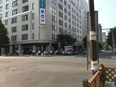 """Vote for Me!"" (sjrankin) Tags: 10july2019 hokkaido japan sapporo downtown buildings election road people candidate loudspeaker skyline pedestrians intersection"