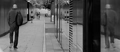 The Reflective Man (Edinburgh Photography) Tags: outdoors man reflective reflection street documentary photojournalism black white monochrome edinburgh nikon d7000