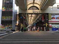 Tanuki-koji 1 (sjrankin) Tags: 10july2019 hokkaido japan sapporo downtown buildings road crosswalk mall coveredmall shops people cars pedestrians tanukikoji raccoonalley shoppingarcade openair