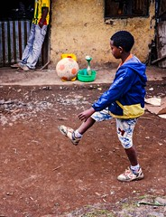 Boots and Ball (Rod Waddington) Tags: africa african afrique afrika äthiopien ethiopia ethiopian ethnic ethnicity etiopia ethiopie etiopian oromo boy streetphotography street candid culture cultural football ball boots outdoor child