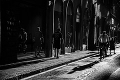 And light appears in the shades of dawning (.KiLTЯo.) Tags: kiltro it italy italia toscana tuscany city florence firenze street urban bw people life bicycle backlight backlighting shadow dark bright