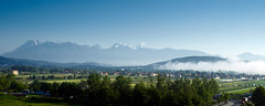 Misty Village (radkuch.13) Tags: europe ljubljana slovenia mountains bluesky green fog mgła mist misty village landscape wideangle snow