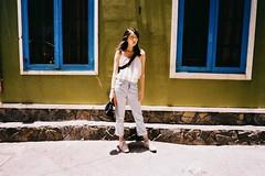 F1050013 (dying slowly) Tags: klassew fujifilm kodak girl wall hochiminh vietnam atmosphere streetphotography street building sunshine