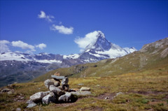 pinhole matterhorn (Ron Layters) Tags: pinholephotography pinhole skink longexposure höhbalmenweg mountains höhbalmenpath matterhorn cairn mountain cervin cervino path shoulder mountainside hill slope grass peak rock snow bluesky landscape valais wallis albental switzerland zermatt slidefilmthenscanned slide transparency fujichrome velvia leica m6 leicam6 ronlayters