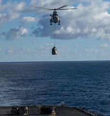 "A Military Sealift Command helicopter drops supplies on the flight deck of the amphibious assault ship USS Wasp (#PACOM) Tags: wasp lhd1 sailors ras talismansabre puma talismansaber ts19 tasmansea usindopacificcommand ""usindopacom"