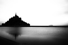 "fine art black & white, an unmistakable silhouette, Mont Saint Michel, Avranches, Manche, Normandie, France (grumpybaldprof) Tags: ""montstmichel"" ""stmichael'smount"" avranches manche normandy france tidal island sea abbey ""bayeuxtapestry"" monastery ""8thcentury"" unesco ""worldheritagesite"" fortifications ""quicksand"" castle bw blackwhite ""blackwhite"" ""blackandwhite"" noireetblanc monochrome ""fineart"" ethereal striking artistic interpretation impressionist stylistic style contrast shadow bright dark black white illuminated mood moody atmosphere atmospheric calm peaceful tranquil restful canon 70d ""canon70d"" sigma 1020 1020mm f456 ""sigma1020mmf456dchsm"" ""wideangle"" ultrawide reflection water wetreflections"