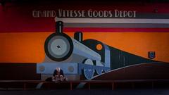 Waitin' for the Train (Stuart_Byles) Tags: mural sitting milkshake colours london bench train wall girl
