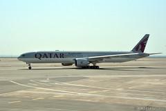 DOH - Qatar Airways (A7-BAJ) (rivarix) Tags: doh hamadinternationalairport dohaqatar airline airways aircraft airplane jetplane jetengine fuselage tail wings verticalstabilizer widebodyaircraft twinaisleplane qatarairways qr boeingb777300er b777 b77w oneworld ow