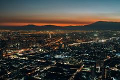 Santiago, Chile (M///S///H) Tags: chile city santiago sunset urban mountains clouds buildings twilight haze downtown cityscape dusk sony ps hazy cerrosancristobal lenstagger rx1