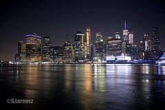 Lower Manhattan Skyline at Night (Lorencz Photography) Tags: city nyc newyorkcity longexposure nightphotography usa newyork water night cityscape review lorenczphotography worldtradecentre wallstreet canon5dmk2 woolworthbuilding