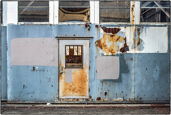 Rusty Door and Grey Shapes (NoJuan) Tags: film filmshooter filmcamera 35mm 35mmfilm 35mmslr canon canonefm canonfilmcamera shootingfilm magnusonpark seattlewa washingtonstate pacificnorthwest