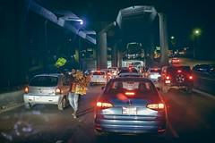 el vendedor (bugeyed_G) Tags: méxico street vendedor hawker vendor freeway urban night traffic travel